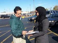 Samina Ijaz of Grayslake, a member of the Ahmadiyya Muslim Community of Zion, delivers a flier explaining Islamic values of peace in Waukegan as part of a national campaign by the global movement to educate Americans about Islam.