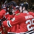 Hawks stay alive, beat Canucks 7-2