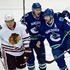 Hawks pay no mind to complaint by Canucks' GM