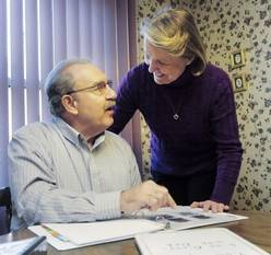 Using notebooks, photographs and a whiteboard helps Steve Riedner communicate with his wife, Mary Beth. The 63-year-old Schaumburg man suffers from Primary Progressive Aphasia, a dementia that initially attacks the part of the brain that processes language and speech.
