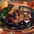 Seared Pork Chops with Sherry Blueberry Sauce over Roasted Kale