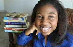 At just 14, Thessalonika Arzu-Embry will be graduating Chicago State University in August with a bachelor's degree in psychology. A resident of the Great Lakes Naval Base, Thessalonika plans to continue her studies in a graduate program before opening a clinic with her mother.