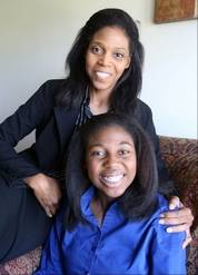 Thessalonika Arzu-Embry with her mother [and schoolmate), Wonder Embry, at their home at Great Lakes. Thessalonika, 14, will be graduating from Chicago State University in August with a bachelor's degree in psychology.