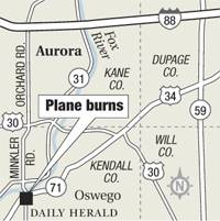 Plane burns in Oswego