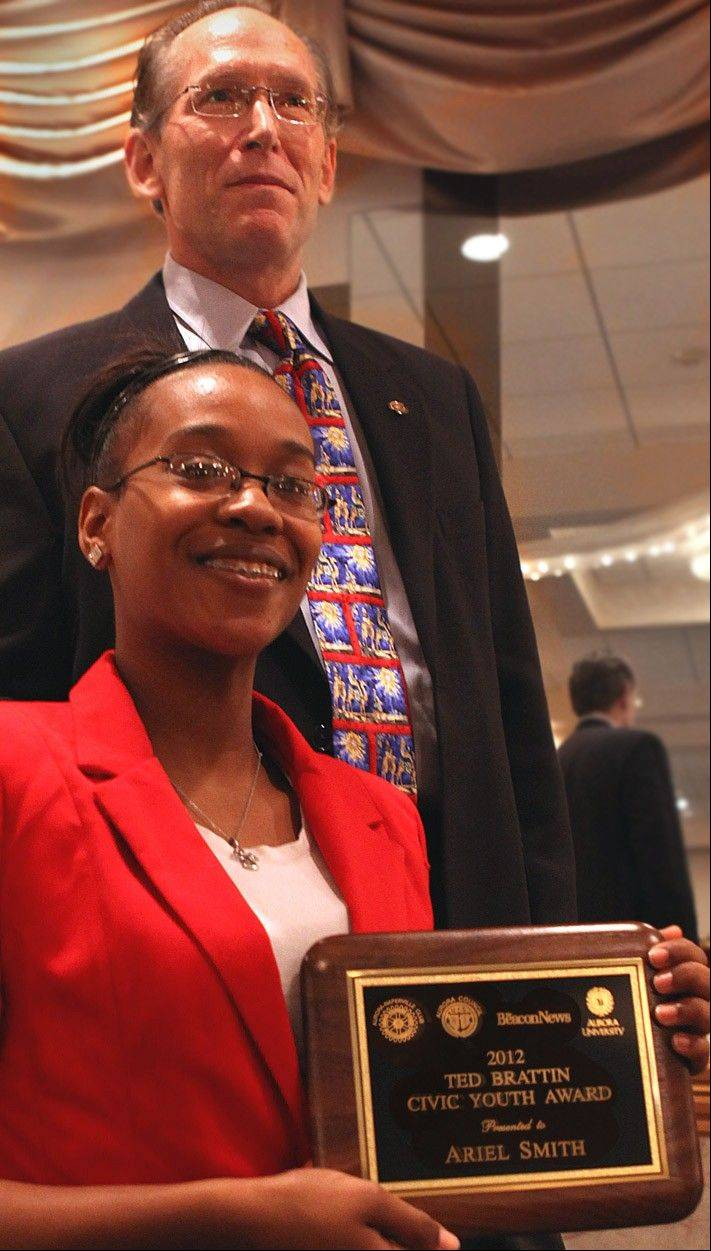 West Aurora High School student Ariel Smith shows off her Brattin Civic Youth Award for community service with Rotarian Tom Guzzardi who presented her with the plaque.