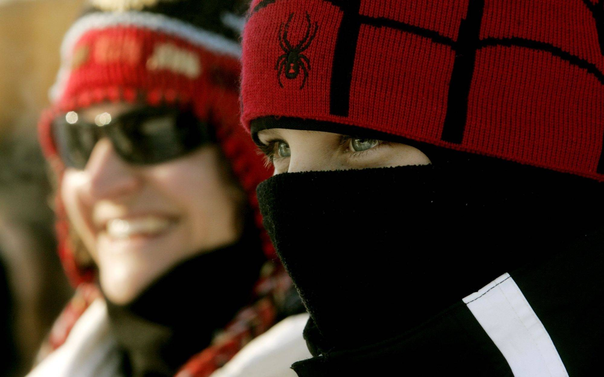 St. Charles residents Lora Severson, left, and Vincent Margiotta, right, bundle up against the cold Sunday during the 32nd Yule Log hunt at Morton Arboretum in Lisle.