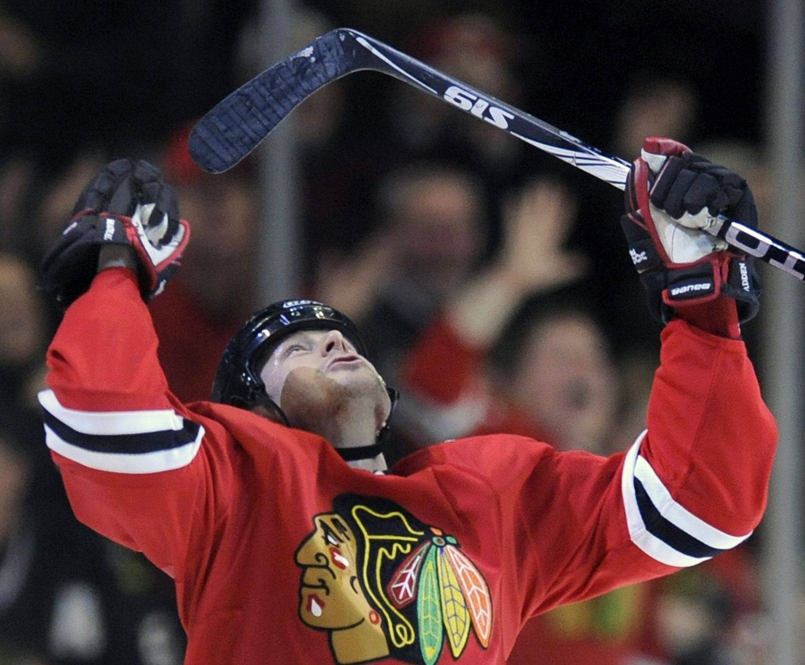 Chicago Blackhawks' John Madden celebrates after scoring against the New Jersey Devils in the third period during an NHL Hockey game in Chicago, Thursday, Dec. 31.