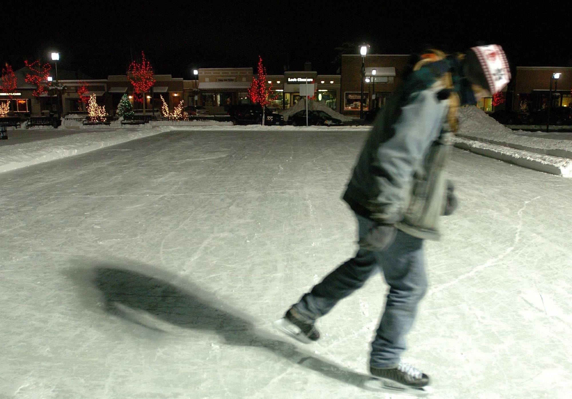A.J. Bruhn enjoys the cold night air Friday while skating on the new outdoor rink at the site of the former Lisle village hall.