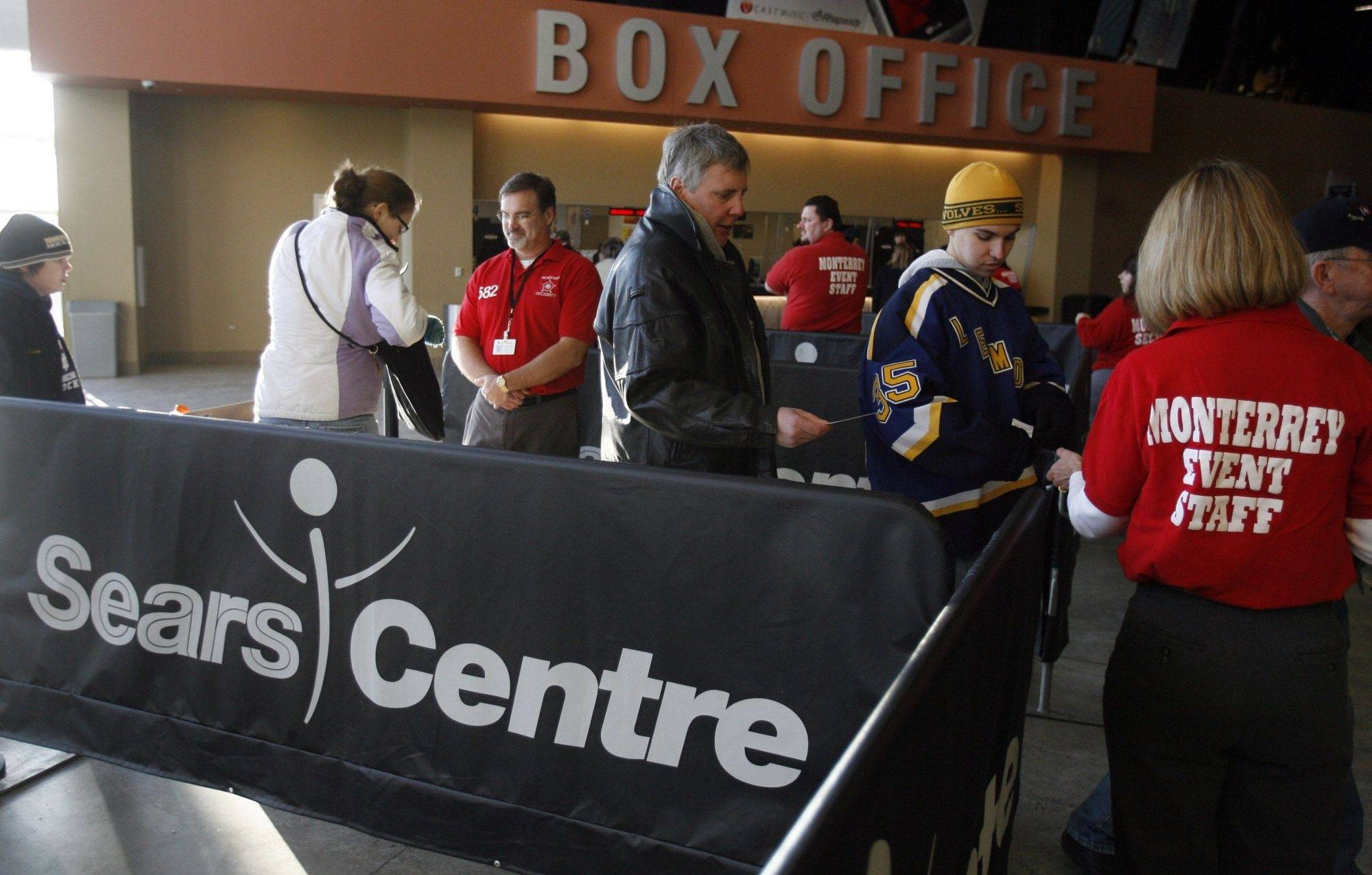 Marilyn Tuckman, an usher, right, checks tickets and gives directions to seating in the Sears Centre Arena for a hockey tournament last weekend, the first event at the Sears Centre under the new manager Global Spectrum.