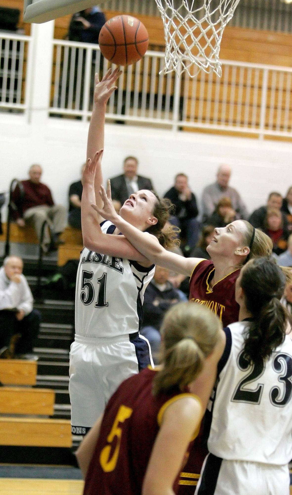 Chelsea Peterson of Lisle reaches up to make a basket in girls basketball action against Westmont on Monday in Lisle.