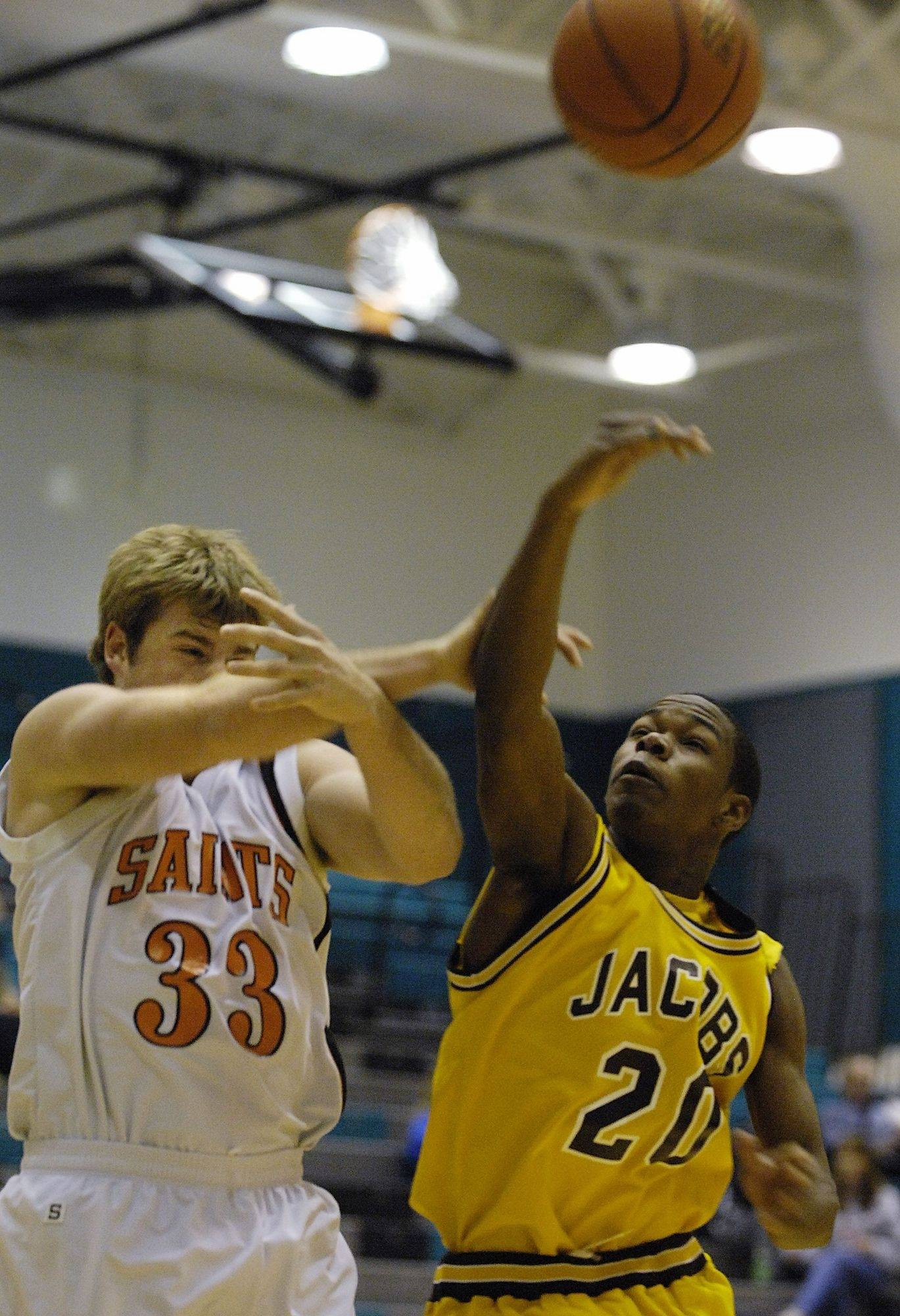 Jacobs' T.J. Brooks is able to swipe a rebound away from St. Charles East's Jess Striedl Monday in Woodstock.
