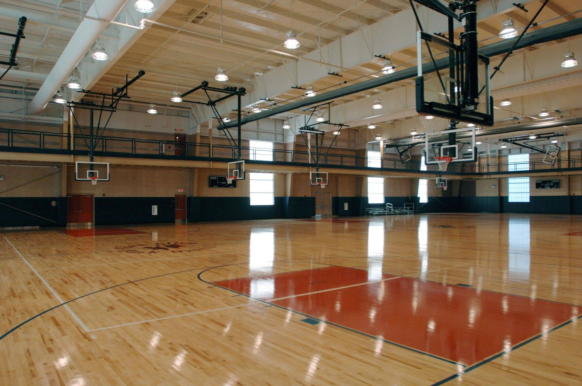 The gym at the Ackerman Sports and Fitness Center in Glen Ellyn on Tuesday. Officials are withholding money from some vendors because of damage caused to the hardwood floors by a leak on the southwest side of the building.