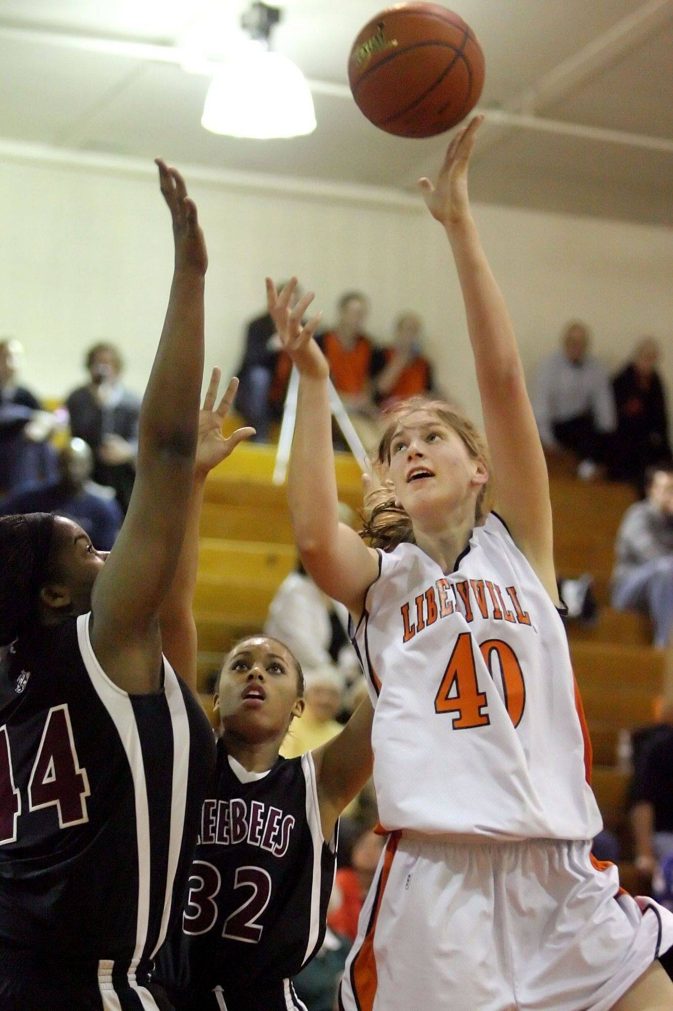 Libertyville's Nicole Kruckman shoots over Zion Benton's Kayla Parks, left, and Carnesha Johnshon during their game Tuesday night at Libertyville High School.