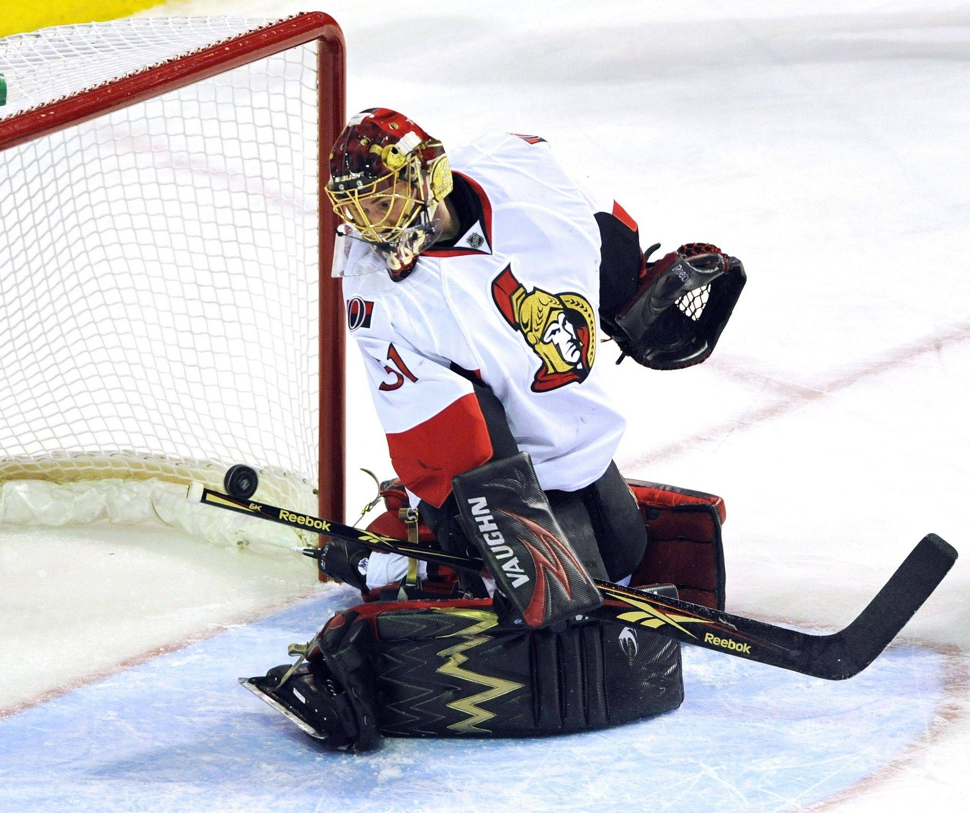 Ottawa Senators goaltender Mike Brodeur is scored on by Montreal Canadiens' Benoit Pouliot (not shown) during the first period of an NHL hockey game in Montreal, Saturday.