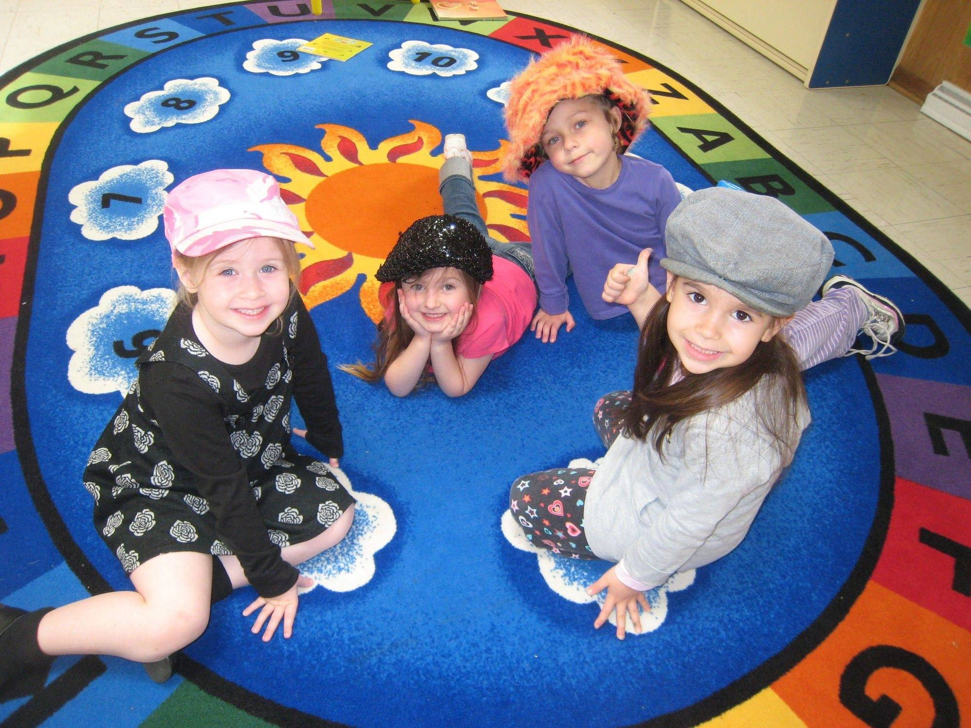 Emma Kehoe, Camden Atkinson, Caitlyn Newton and Jocelyn Silk are among the preschoolers who give the Salt Creek Park District preschool a thumbs-up vote.