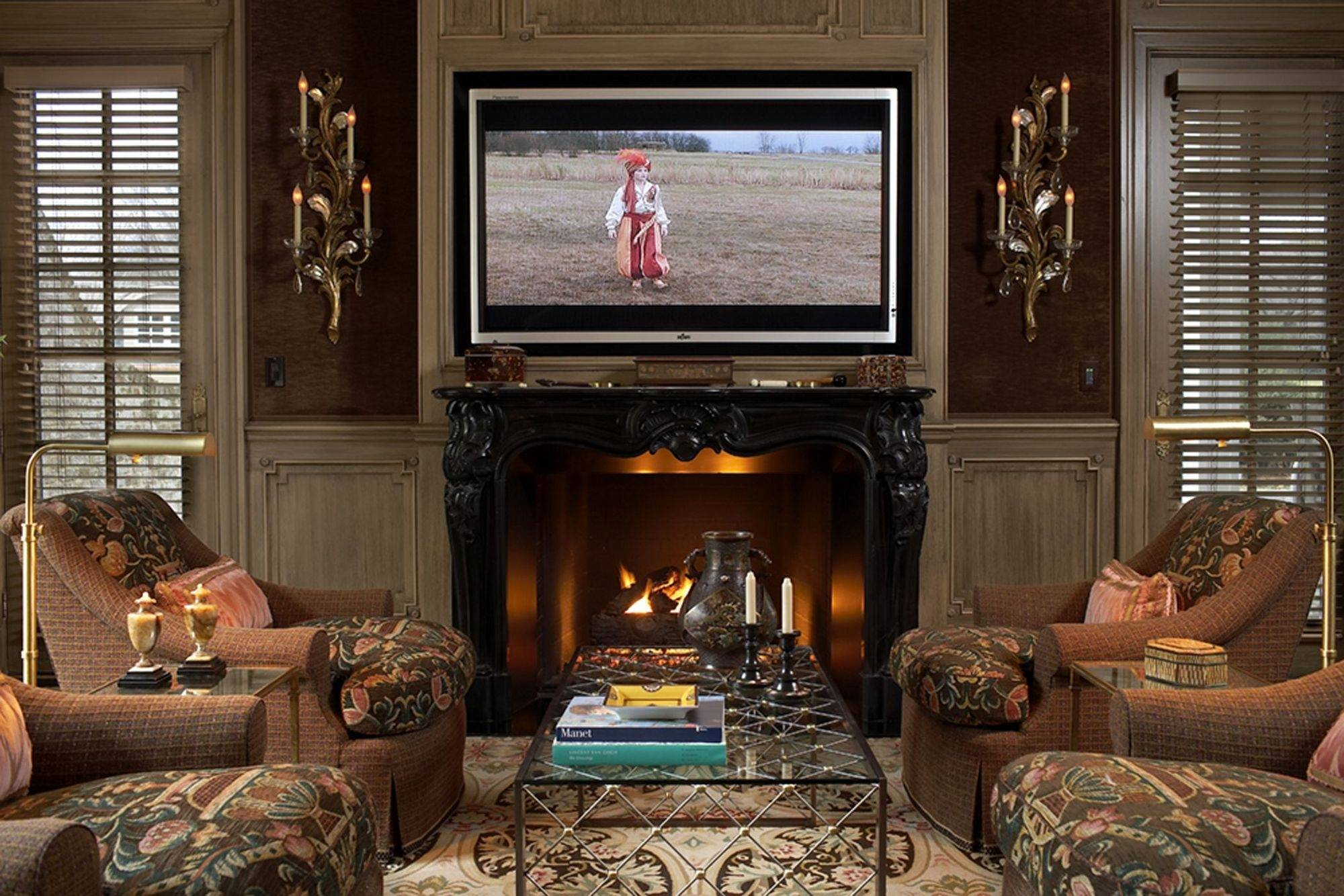 Scott Salvator Made The TV The Star By Hanging It Above A Fireplace And  Framing It
