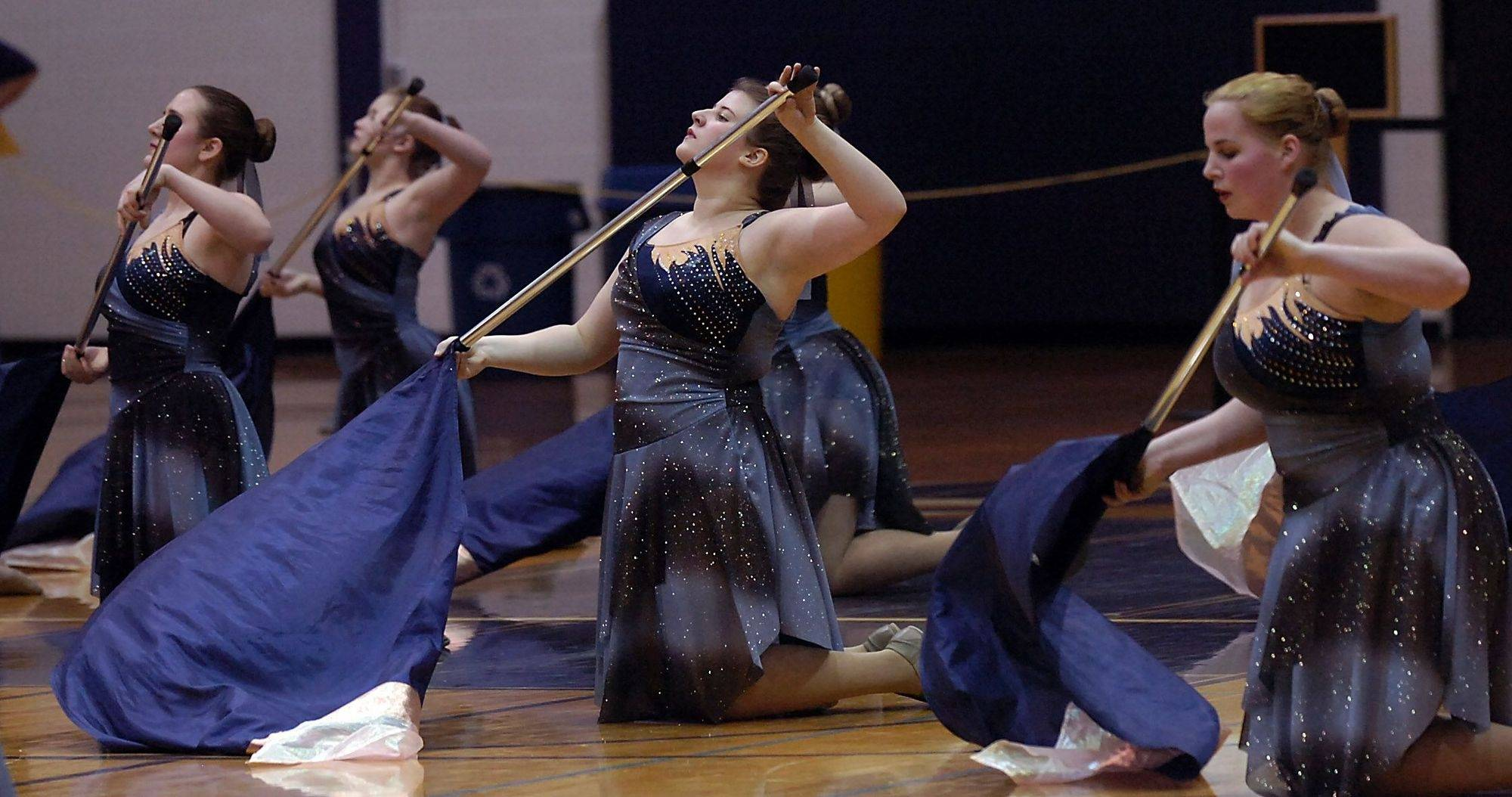 The St. Charles East Lyrical Flag Class AAA team shows off its skills performing a musical routine at Rolling Meadows High School on Saturday.