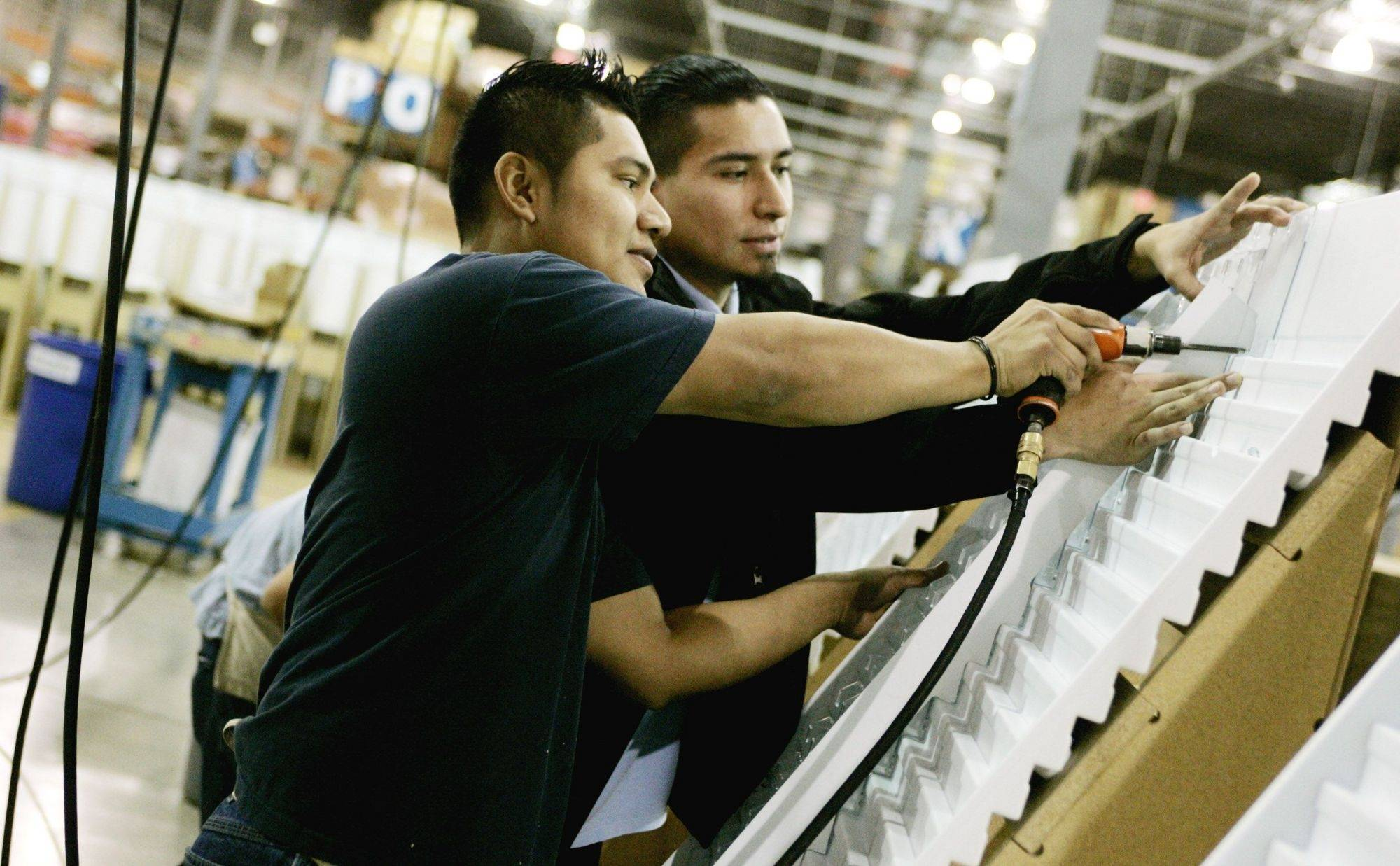Eric Rangel, right, works with Luis Mendez, left, at Niven Marketing Group in Carol Stream.