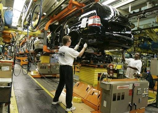 Ford Motor Co. employees work on the assembly line at the company's Chicago Assembly Plant