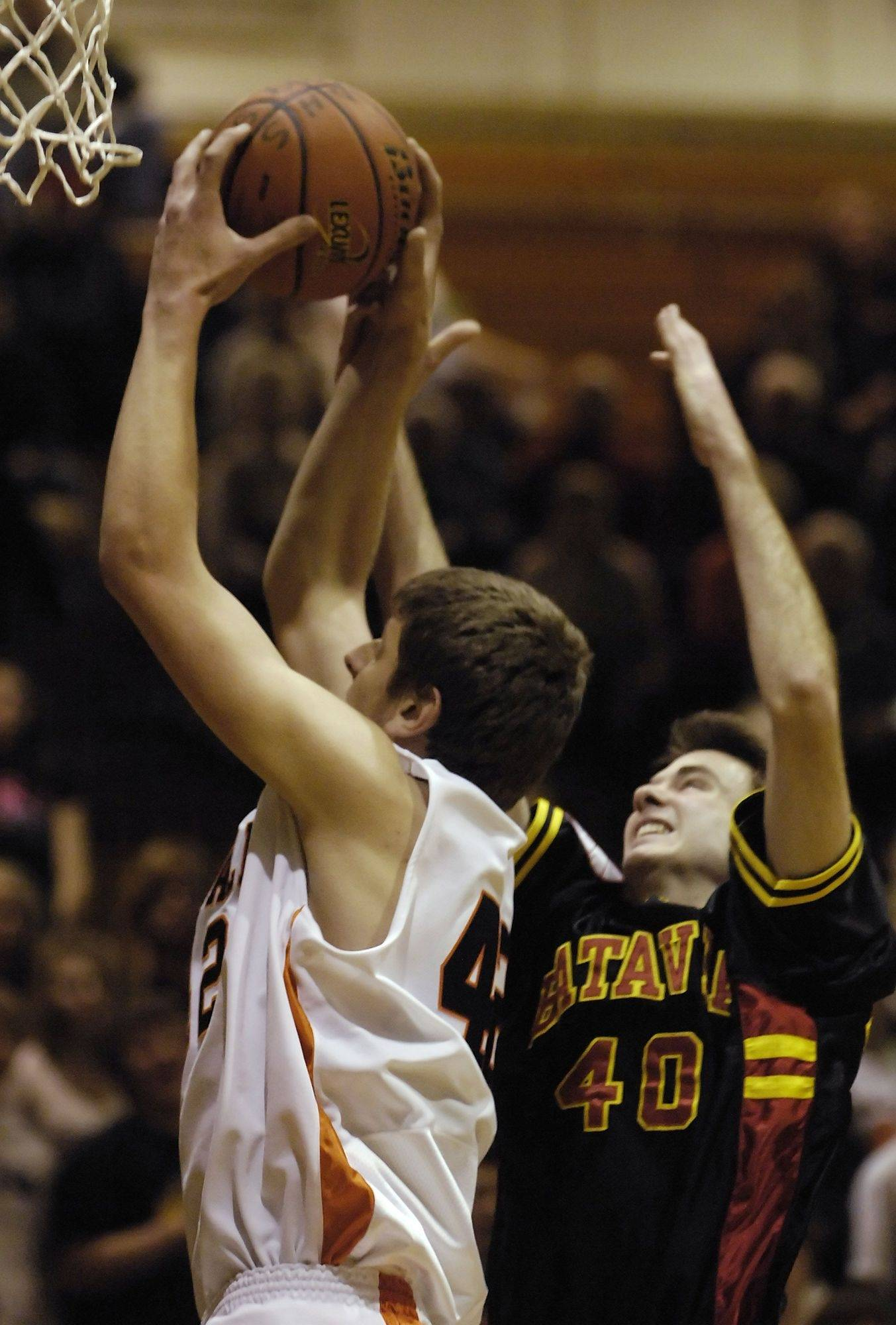 Batavia's Levi Maxey battles for a rebound against DeKalb's Jordan Threloff, who pulled down a career-high 26 leading the Barbs to a 68-65 come-from-behind win in overtime Tuesday.