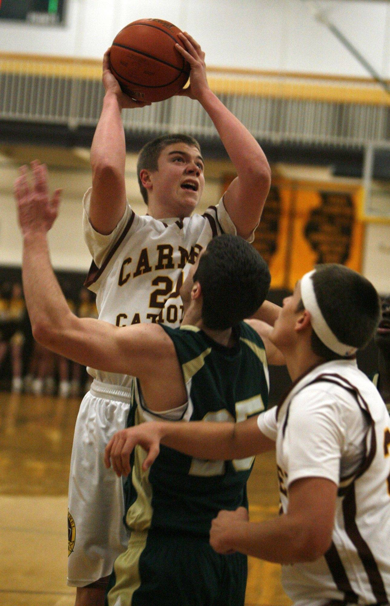 Carmel's Daniel Mooney puts up a shot Friday against St. Patrick. The host Corsairs lost 61-42 in East Suburban Catholic Conference action. See story on Page 6.