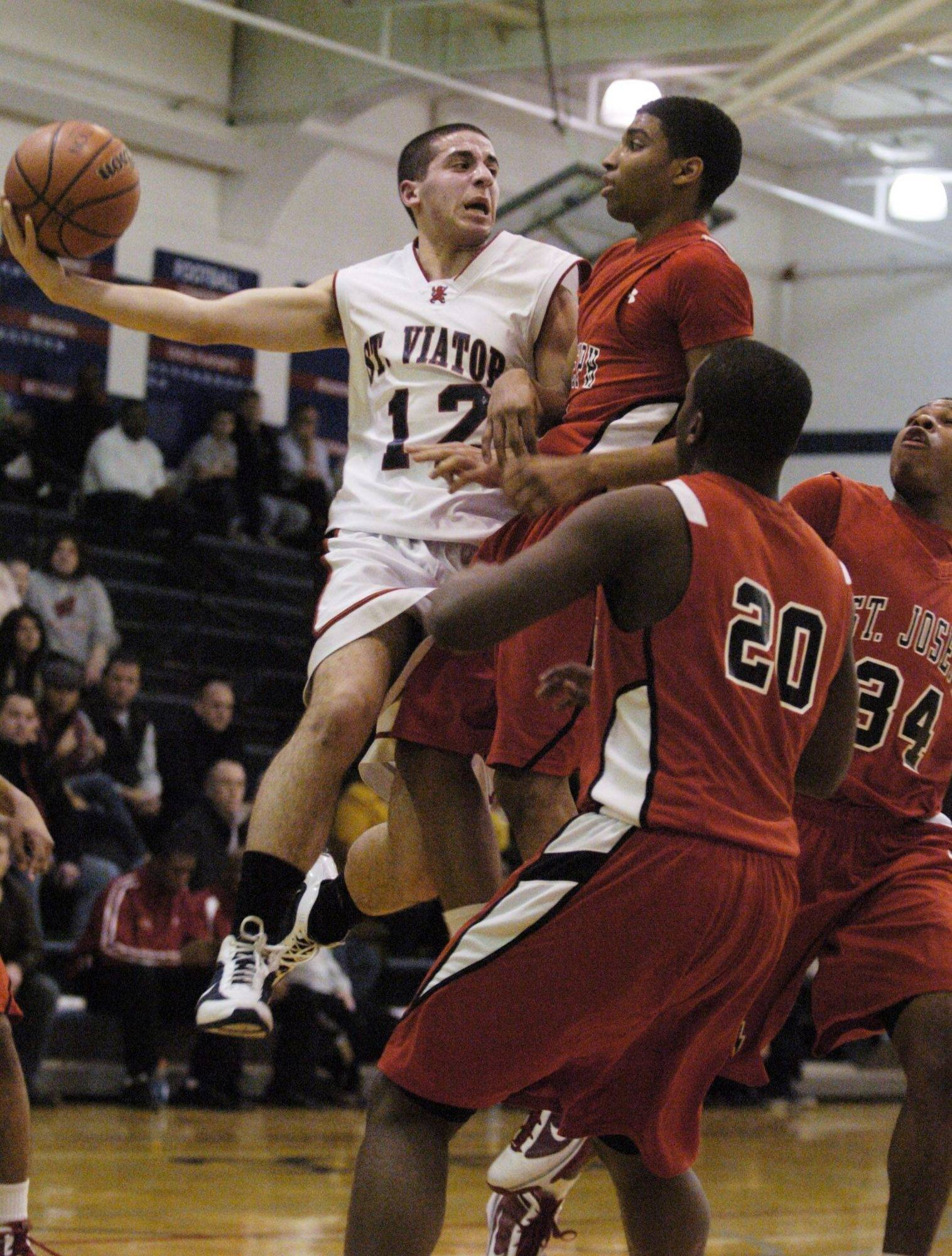 St. Viator's Alan Aboona looks to pass during Wednesday's game against St. Joseph.