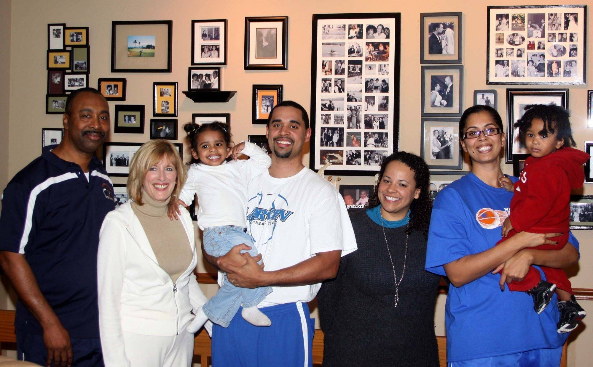 Deryl and Marlene Carter, left, pose with their three children and two grandchildren at their Elgin home. From left, Deryl, Marlene, Mia with her dad Deryn, Katy Potts, and Corry Irvin with her son Mac. Corry is head girls basketball coach at Whitney Young High School, and Deryn is head boys basketball coach at Larkin High School.