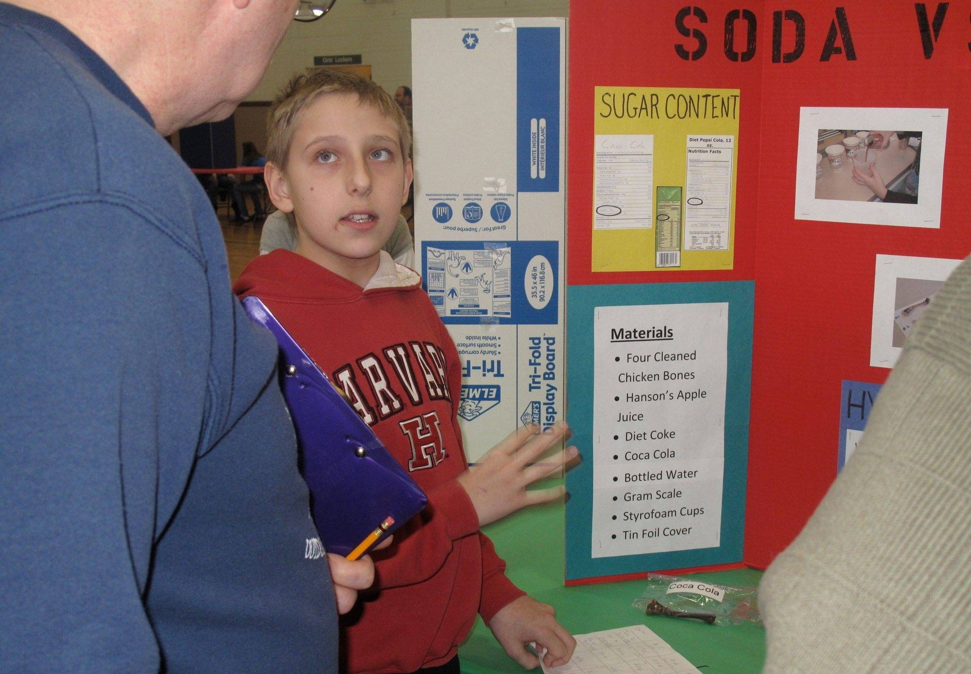 F.E. Peacock Middle School sixth grader Henry Miller discusses his project at the school's science fair.