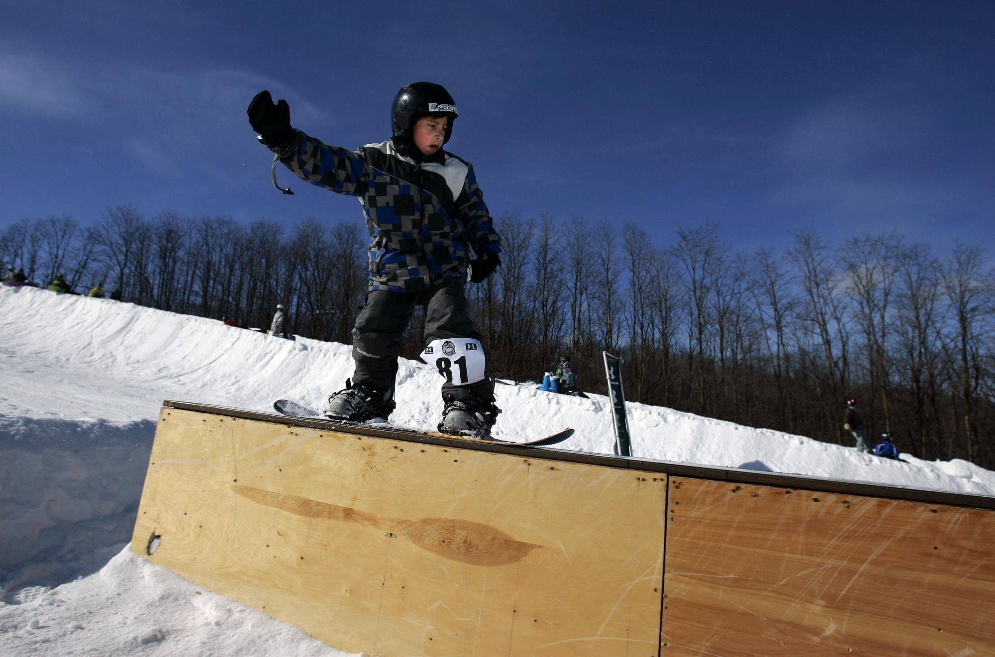 Brian Miller, 9, of West Dundee, competes Saturday during the 3rd Rail Jam at Raging Buffalo in Algonquin. The competition unites amateur skiers and riders with elements of hip hop culture.