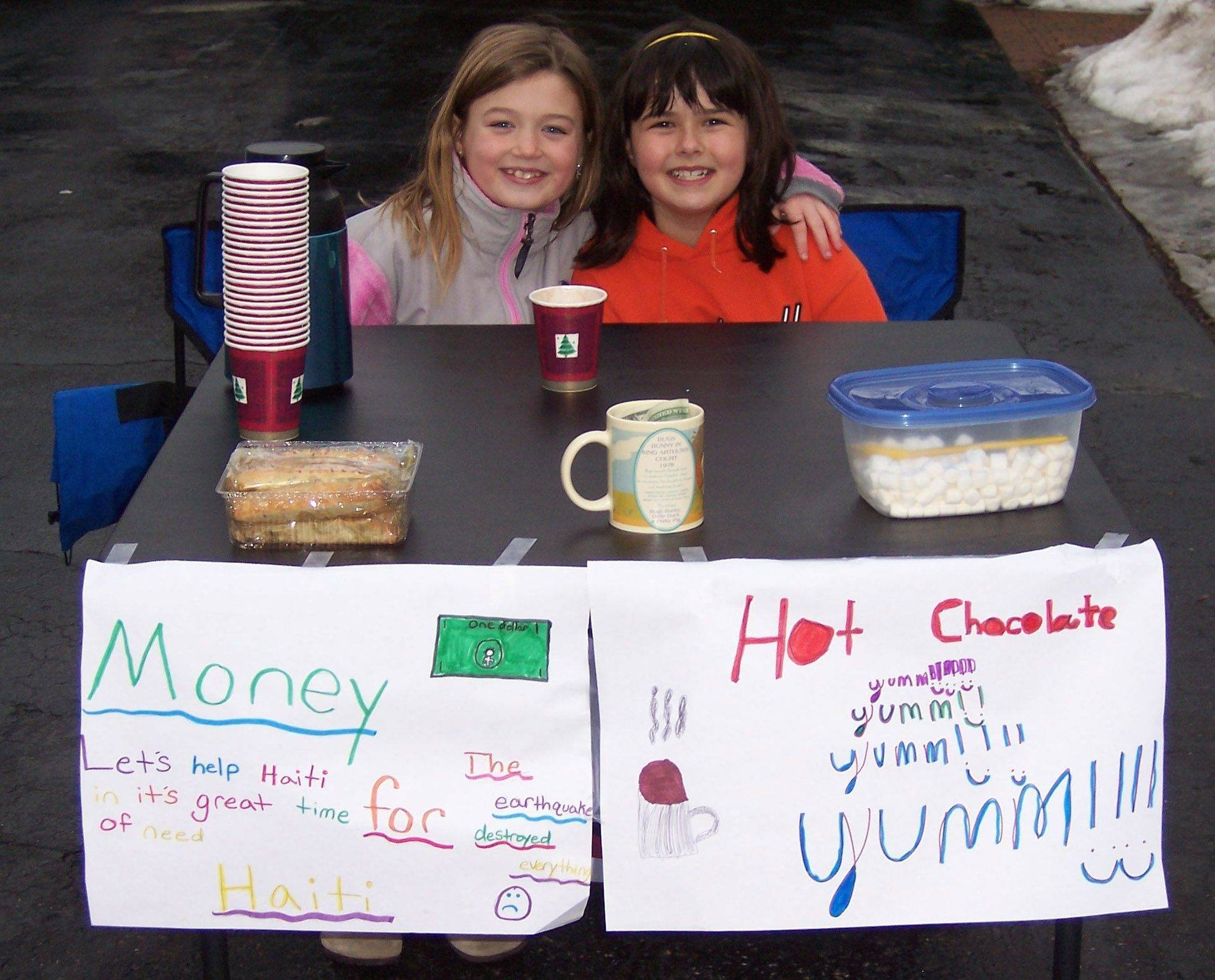 "Rockland fourth-grader Caroline Phagan, left, and Butterfield School fourth-grader Erin Rooney spent three hours selling ""Hot Chocolate for Haiti"" in a Libertyville neighborhood."