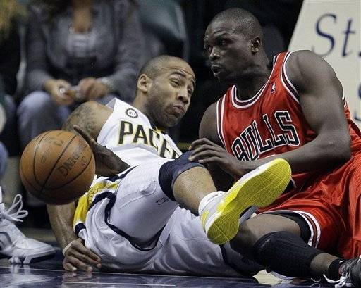 Chicago Bulls' Luol Deng, right, draws the foul as he crashes into Indiana Pacers' Dahntay Jones in the second half in Indianapolis, Tuesday.
