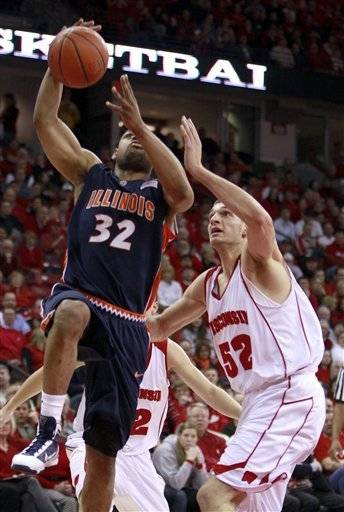 Illinois' Demetri McCamey (32) shoots past Wisconsin's Keaton Nankivil (52) during the first half Tuesday.