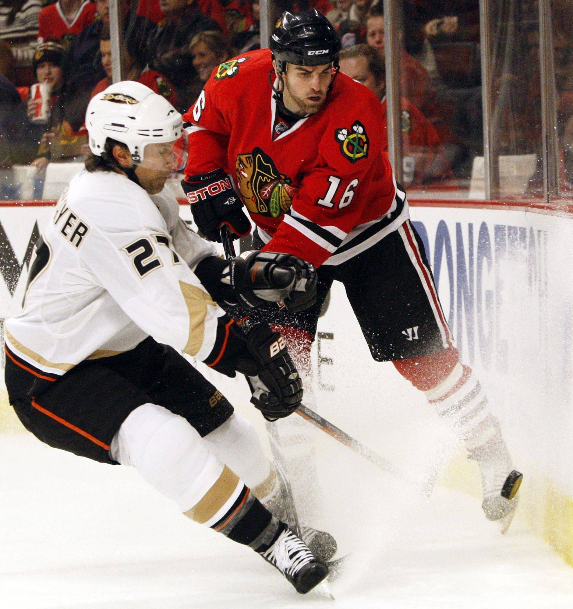A lot of playoff contenders in the NHL could use the services of Anaheim's Scott Niedermayer, left, who battled Andrew Ladd for the puck during a game in Chicago last month.