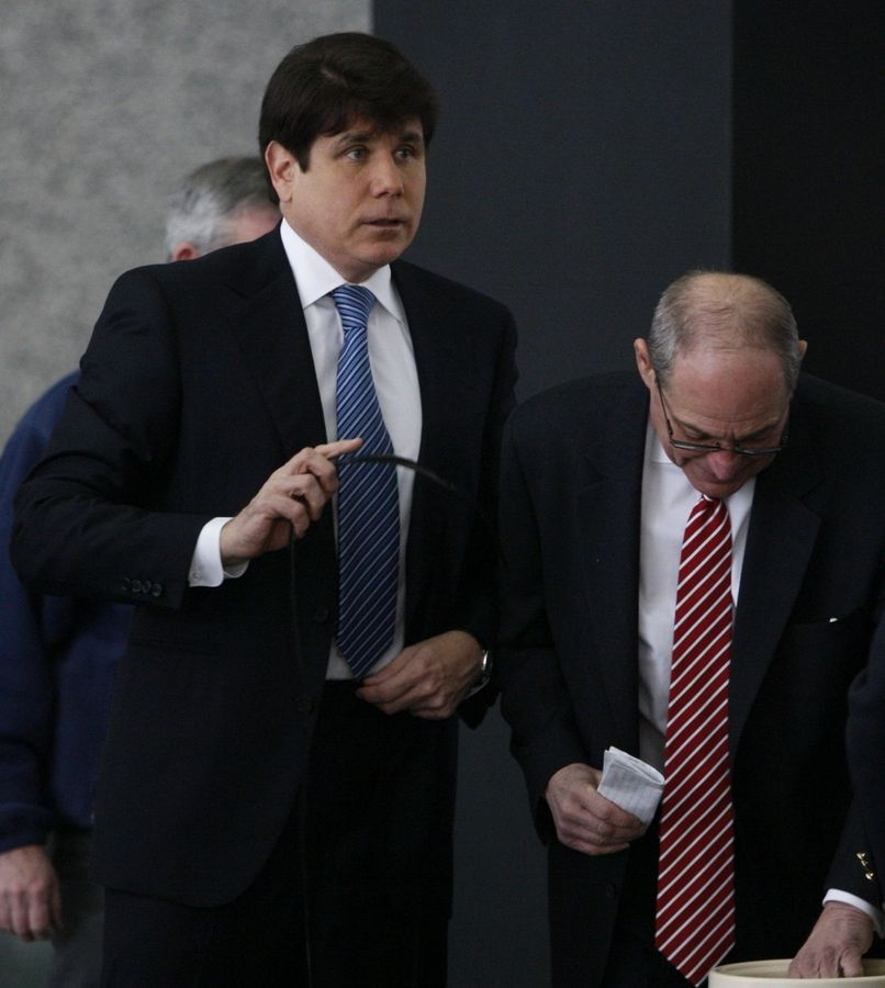 Former Illinois Gov. Rod Blagojevich arrives at the Federal Court building, Wednesday to face revised charges in his upcoming federal corruption trial.