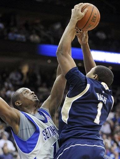 Seton Hall's Herb Pope, left, blocks a shot by Notre Dame' Tyrone Nash during the second half Thursday.