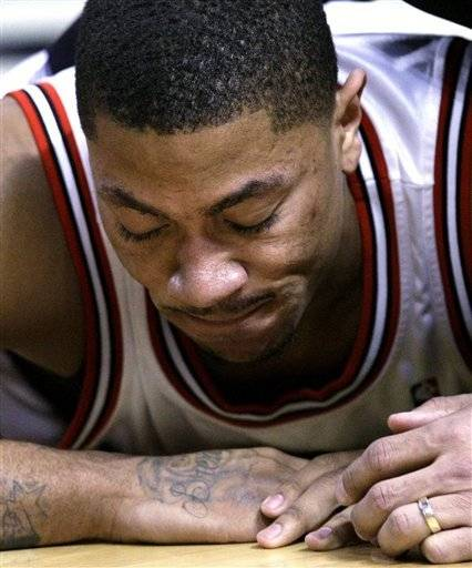 Chicago Bulls guard Derrick Rose reacts after colliding with Orlando Magic center Dwight Howard during Wednesday's game.  The Bulls are optimistic Rose will be able to play in Sunday's All-Star Game.