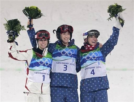 Olympic champion in women's moguls Hannah Kearney of the USA, center, runner up Jennifer Heil of Canada, left and third placed Shannon Bahrke of the USA, right.