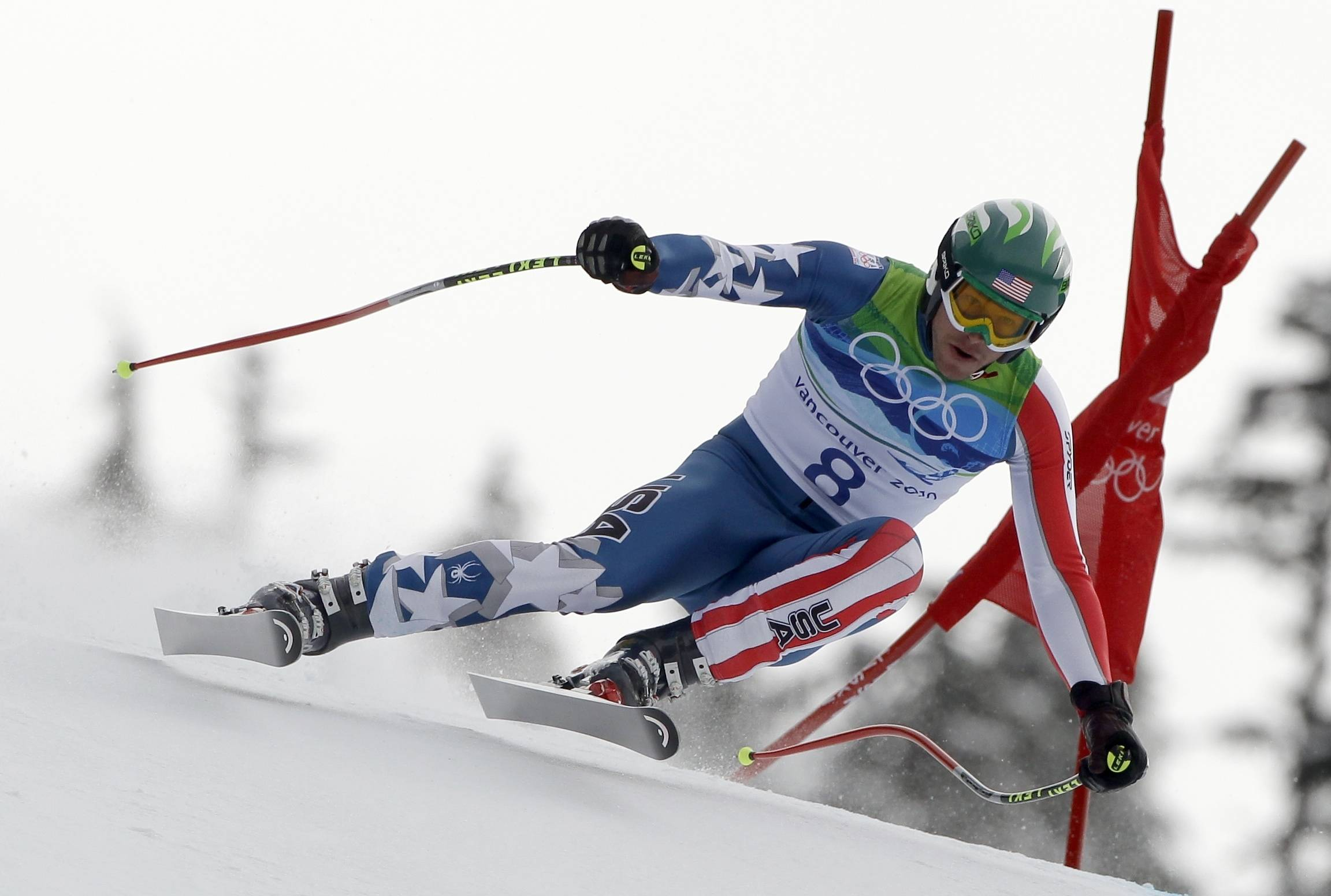 Bode Miller of the United States speeds down the course during the Men's Downhill.