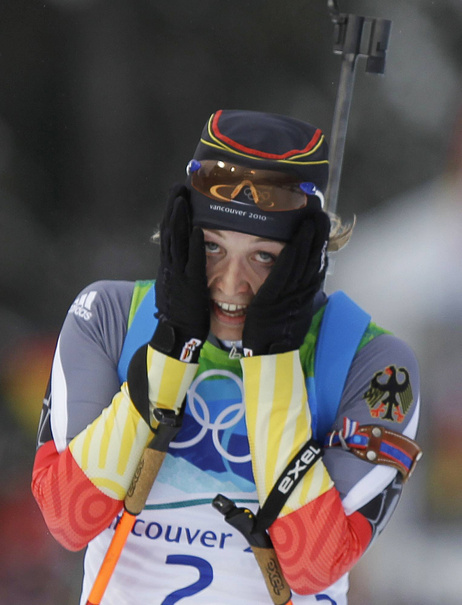 Germany's Magdalena Neuner celebrates as she crosses the finish line to win the women's biathlon 10 km pursuit race.