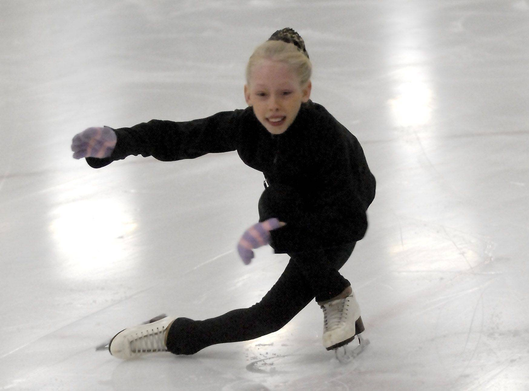 Bradie Tennell of Carpentersville performs a sit spin during practice at Twin Rinks Ice Pavilion in Buffalo Grove.