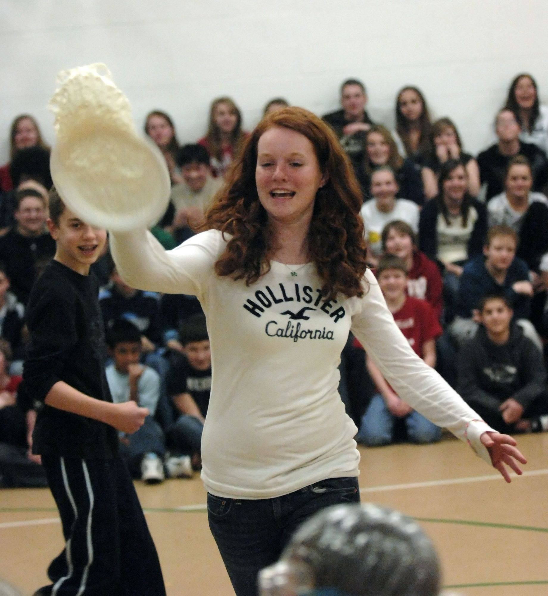 Eighth-grader Allison Walsh lets a whipped cream pie fly.