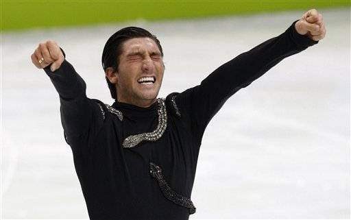 Evan Lysacek of the United States reacts after his performance in the men's free program figure skating competition Thursday.