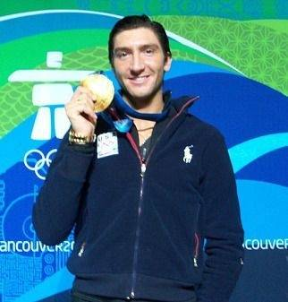 Naperville's Evan Lysacek displays his gold medal Friday.
