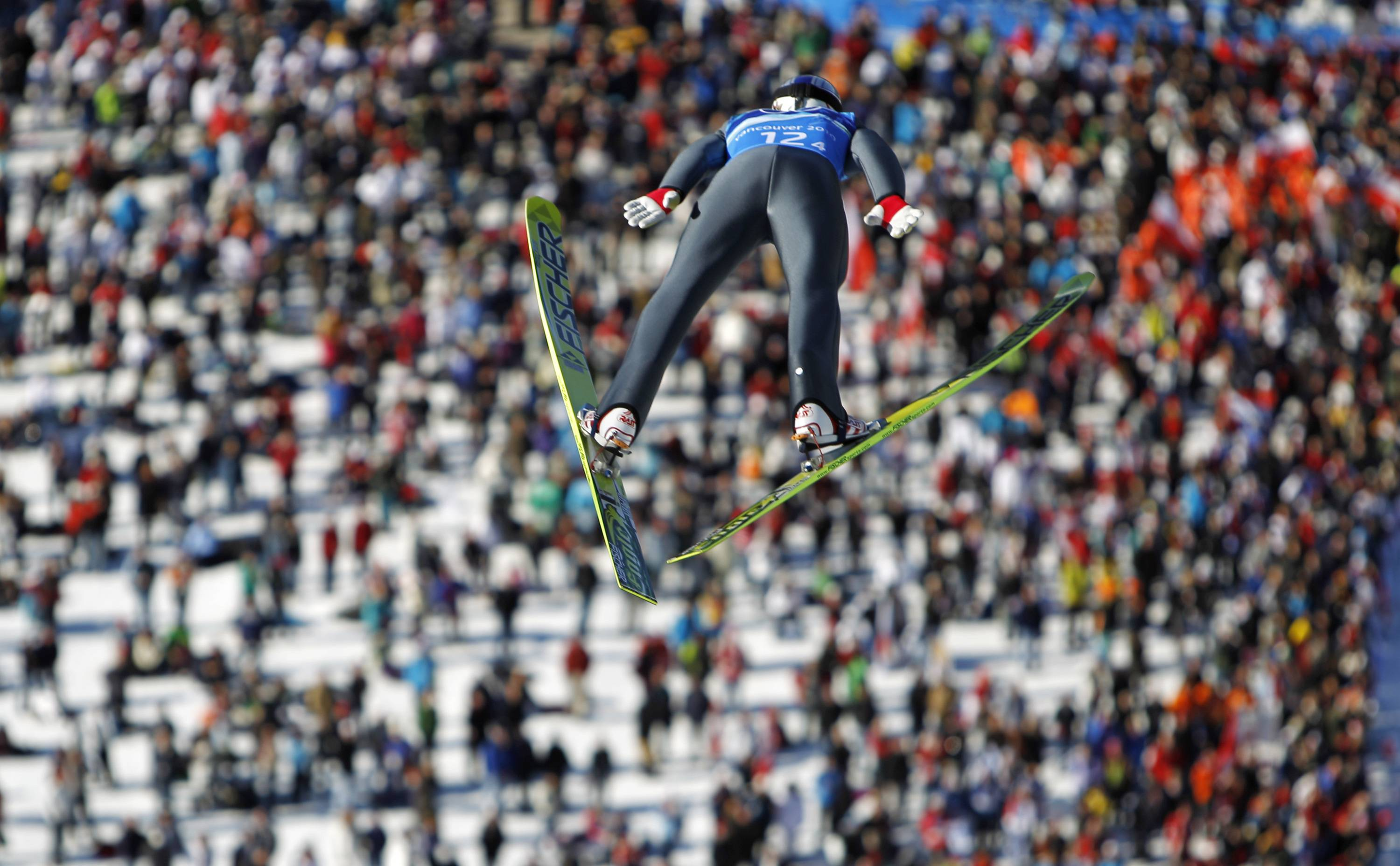 Austria's Gregor Schlierenzauer makes his first competition jump during the Men's ski jumping team event from the large hill.