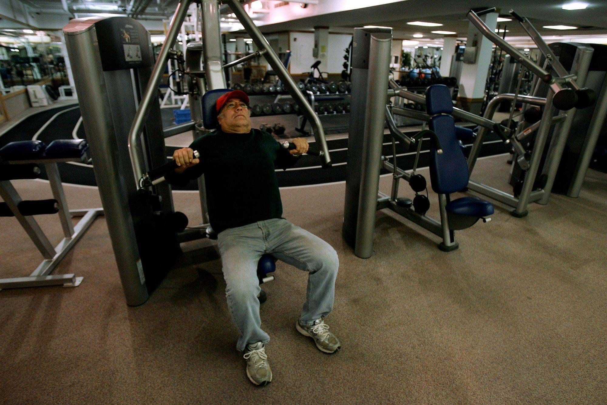 Chon Perez of Round Lake Park lifts weights Monday at the Round Lake Area Park District's fitness center. The facility closes April 30.