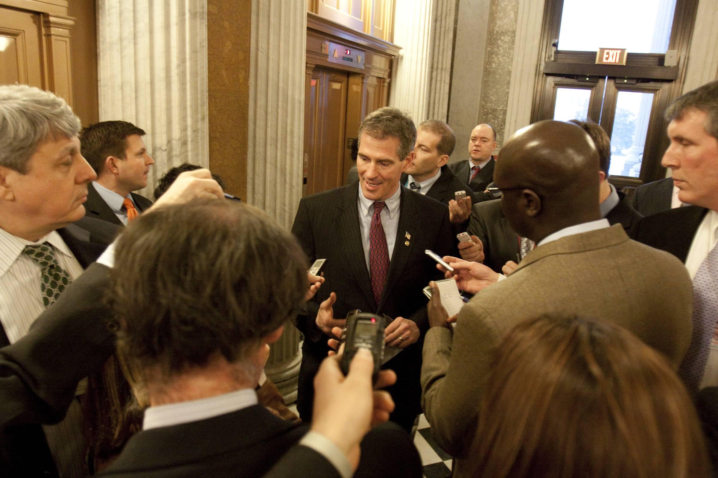Sen. Scott Brown, R-Mass., talks to reporters after voting on the jobs bill.