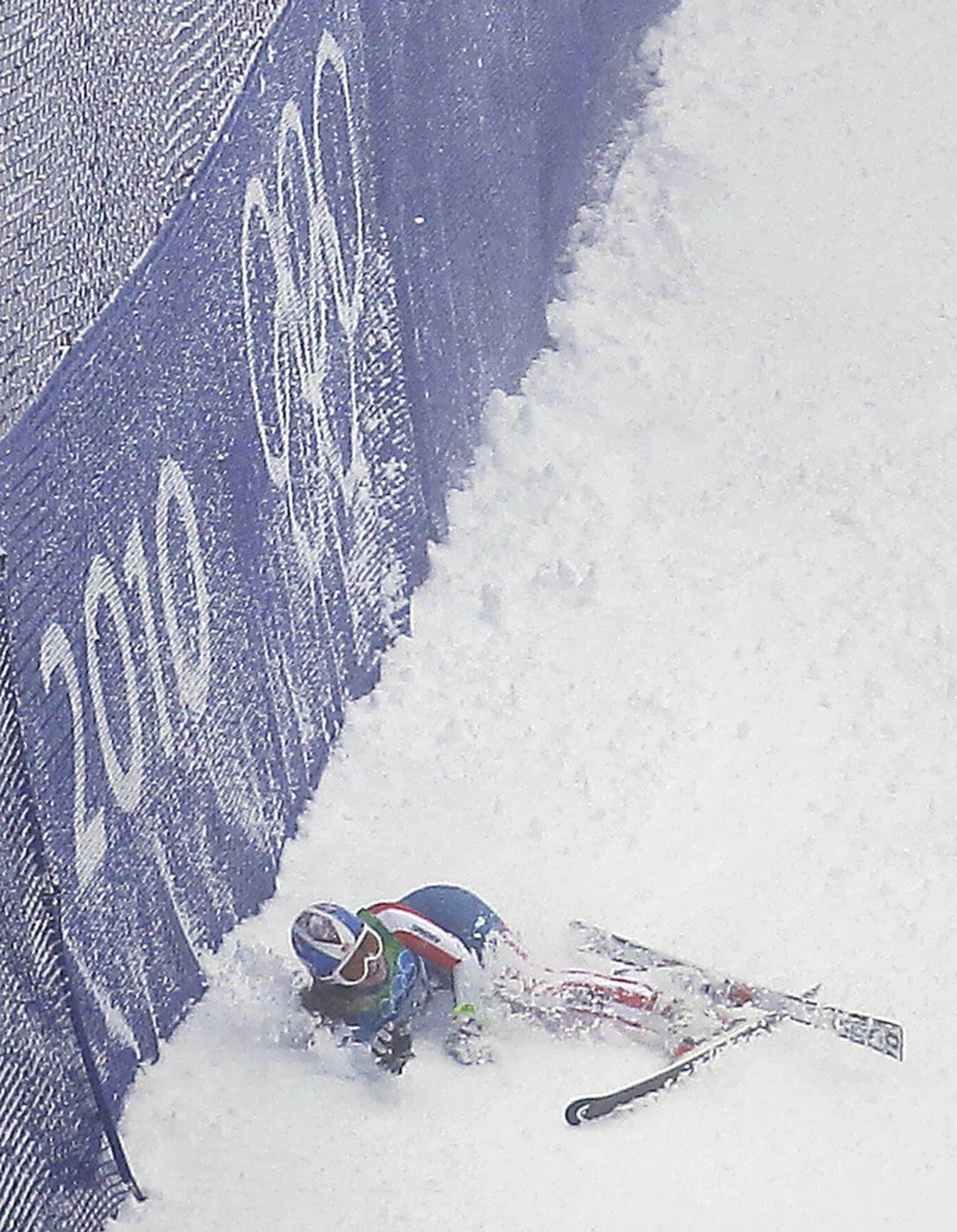 Lindsey Vonn of the United States lays in the snow after crashing during the first run of the Women's giant slalom.