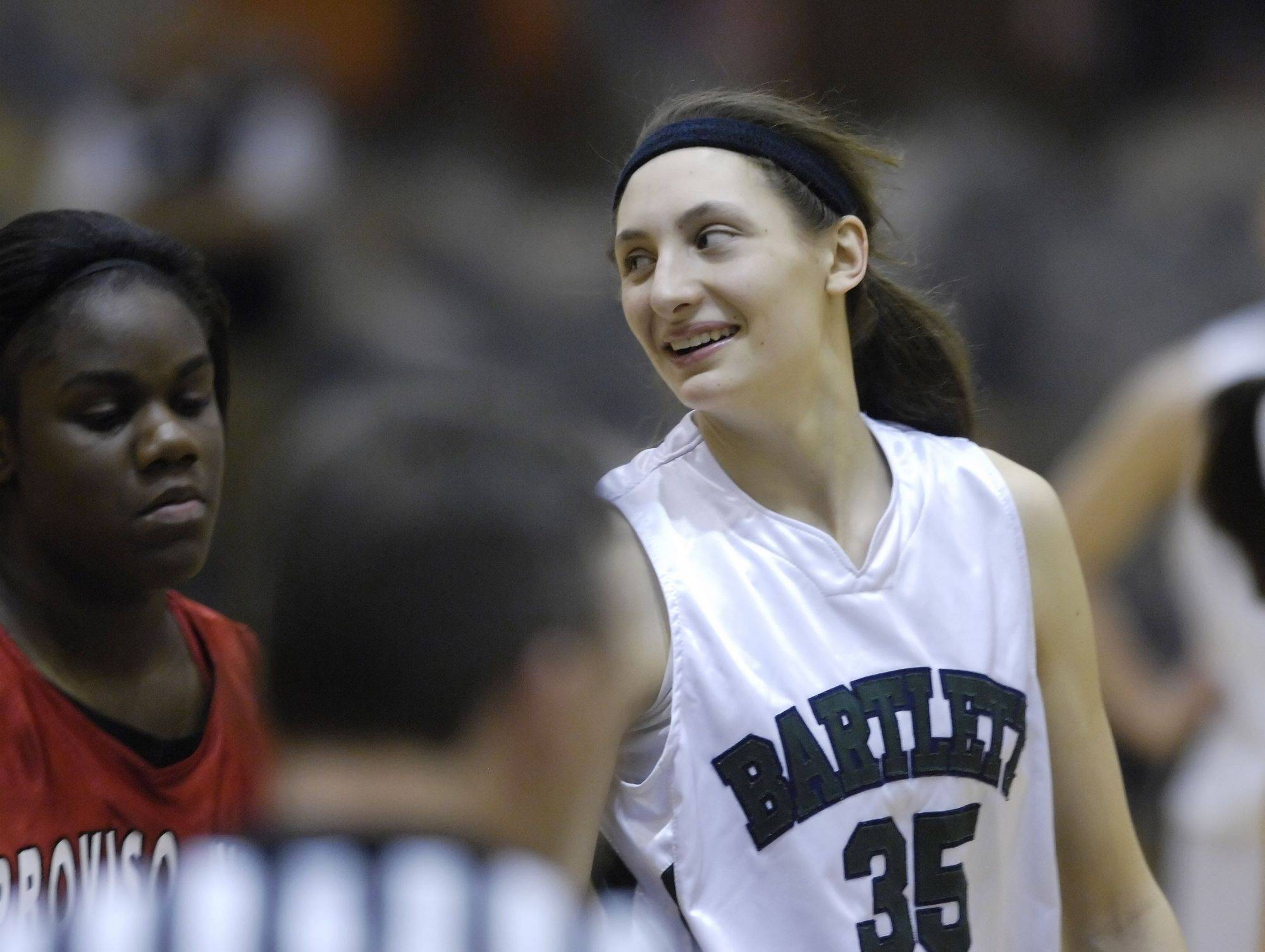 Bartlett's Jacki Gulczynski smiles toward coach Denise Sarna in the final minute against Proviso West Tuesday in Roselle.