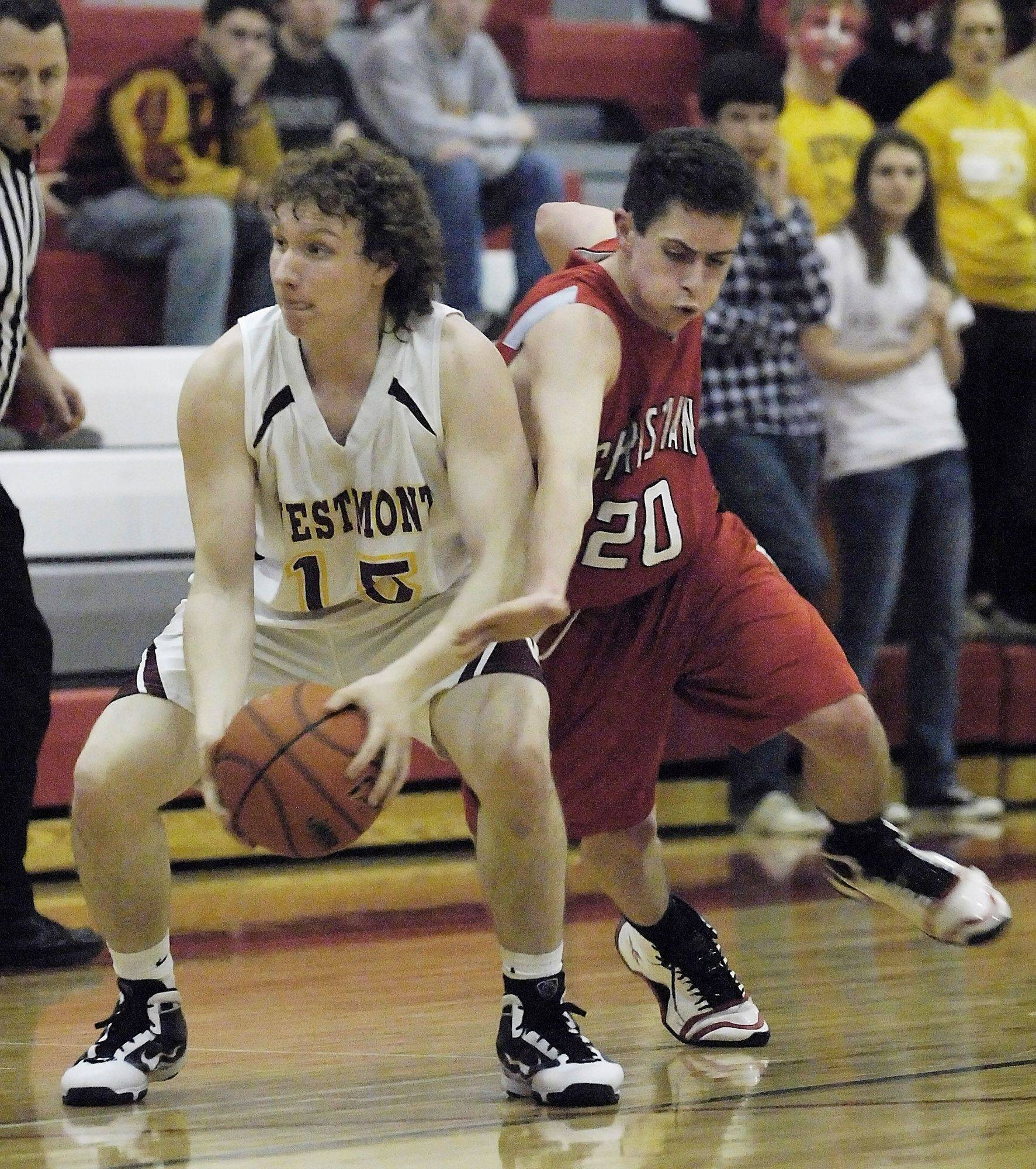 Aurora Christian's Josh Haugen tries to steal the ball from Westmont's Kevin Good.