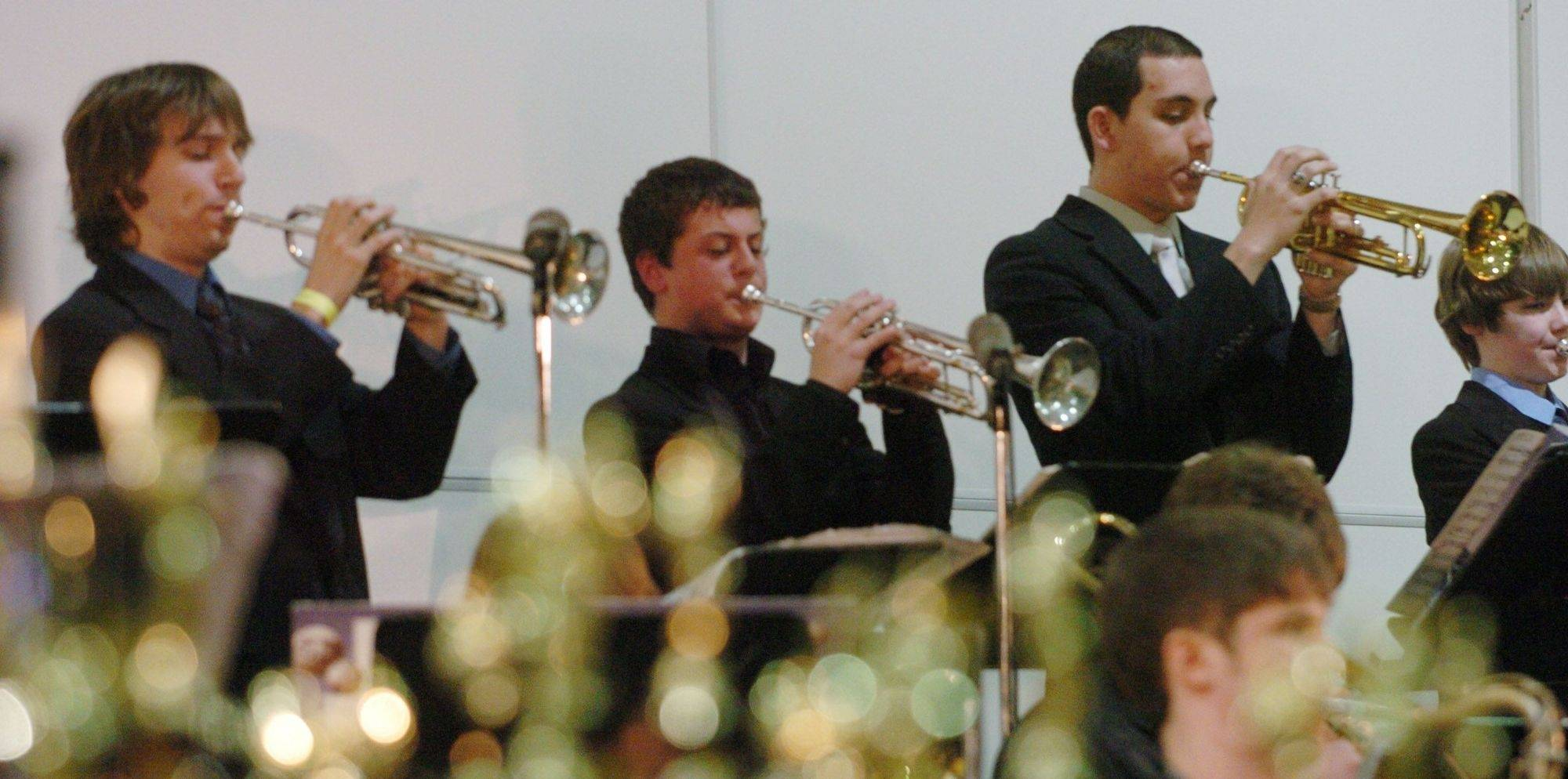 The trumpet section of the Warren High School Band gets funky during its Jazz in the Meadows performance.